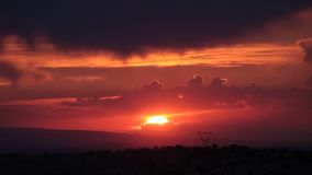 Sunset and the rain cloud. Red cloud stock footage