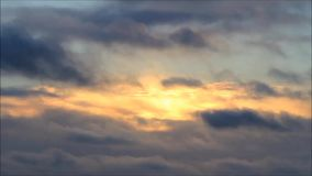 Sunset with rain clouds. In fast motion stock video footage