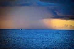 Sunset and rain Stock Photography