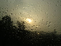 Sunset and rain. Combination of sunset with droplets of rain water Stock Photography