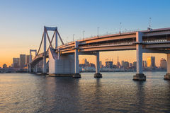 Sunset at Rainbow bridge with Tokyo tower in background Royalty Free Stock Photos
