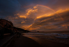 Sunset and rainbow. The sunset on the seaside of Alassio with a beautiful rainbow Royalty Free Stock Image
