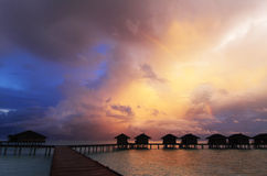Sunset and rainbow after storm, Maldives Stock Photo