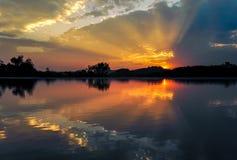 Sunset ray over lake Stock Photos