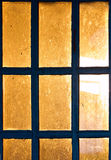 Sunset rays beaming through the old window background. Royalty Free Stock Images
