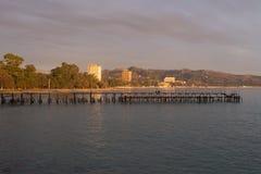 Sunset rays illuminate the city. Sunset rays illuminate the evening coastal city Stock Photography