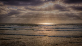 Background image of Scripps Pier Beach, after the sunset. Rays of light sunset at La Jolla Beach, San Diego, California stock images