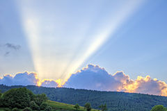 Sunset with rays of light over mountain ridge Stock Photography