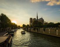 Sunset rays over Notre Dame cathedral Stock Images