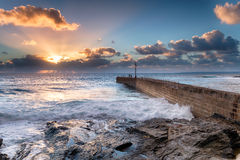 Sunset Rays over Porthleven Pier Stock Photography