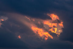 Sunset with rays. Passing through the clouds Royalty Free Stock Images