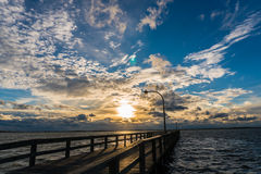 Sunset with rays on pier Stock Photography