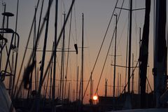 Sunset in real nautical club of Valencia Spain. Sunset in real nautical club of Valencia, group of sailboats on the coast of the Mediterranean. Valencia - Pinedo Stock Photo
