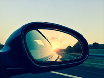 Sunset in a rear view mirror Royalty Free Stock Photography
