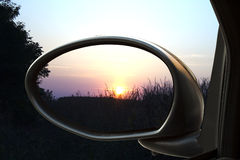 Sunset in the rearviewmirror Royalty Free Stock Photography