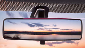 Sunset in the rearviewmirror Royalty Free Stock Images