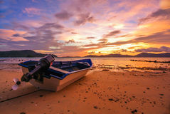 Sunset Red Blue Sky Twilight  on the beach. Boat Sunset Red Sky Twilight  rock beach Stock Photo