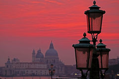 Sunset red and lanterns lit street in Venice, Italy Stock Photo