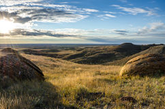 Sunset at Red Rock Coulee. Odd round red concretions randomly scattered across the land in Alberta, Canada during sunset Stock Photos