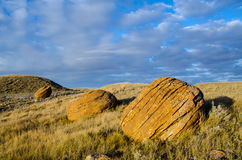 Sunset at Red Rock Coulee. Odd round red concretions randomly scattered across the land in Alberta, Canada during sunset Stock Image