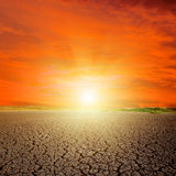 Sunset in red sky over desert Royalty Free Stock Photography