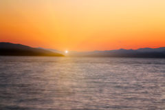 Sunset with red sky over sea beach Royalty Free Stock Photo