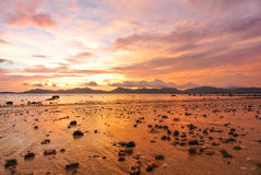 Sunset Red Sky Twilight on the beach. Sunset Red Sky Twilight rock beach stock photography