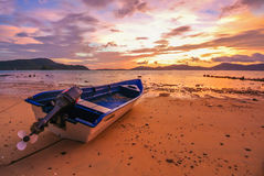 Sunset and Red Sky Twilight. Boat Sunset Red Sky Twilight  rock beach Stock Images