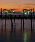 Sunset at Redondo Beach Pier. Sun setting on the pier at Redondo Beach in southern California stock images