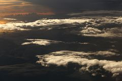 Sunset White Cloud sky at high level attitude, view from window Stock Photos