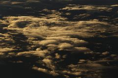 Sunset White Cloud sky at high level attitude, view from window Royalty Free Stock Image