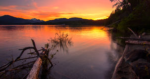 Sunset reflect in Lake with Mountains in Distance Stock Photos