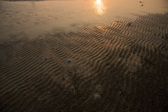 Sunset reflect on sand waves. Royalty Free Stock Photography