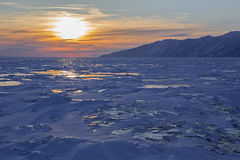 Sunset reflected in the ice floes. Royalty Free Stock Images