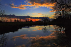 Sunset reflected in still water Royalty Free Stock Image