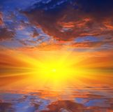 Sunset reflected in a water Royalty Free Stock Image