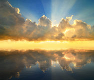 Sunset reflected in a water Royalty Free Stock Photos