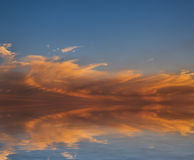 Sunset reflected in water. Stock Photography