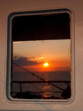 Sunset reflected from the Window on ferry Royalty Free Stock Photo