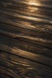 Sunset reflected on wood. Royalty Free Stock Image