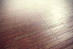 Sunset reflected on wooden panels. Stock Photos