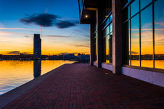 Sunset reflecting in a building on the waterfront in Fells Point Royalty Free Stock Photography