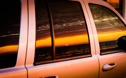 Sunset Reflecting On Car Window. Setting sun scenery in the Marmara region of the country Turkey - reflecting on the side windows of a car Royalty Free Stock Images