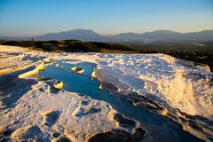 Beatiful sunset in Pamukkale valley. Sunset reflecting over the beautiful white stone cascade in the Pamukkale Royalty Free Stock Photography