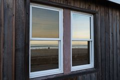 Sunset reflecting in windows on Pacific Beach Royalty Free Stock Photo