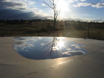 Sunset Reflection. Reflection of the sunset on a water tank Stock Image