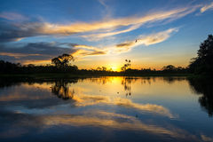 Sunset and Reflection in the Amazon Royalty Free Stock Photos