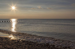 Sunset and reflection on beach at Barmouth Stock Photo