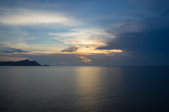 Sunset with reflection. On blue sea stock photography
