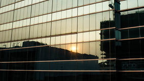 Sunset reflection on building windows. A photo of a reflection of sunset on the windows of a commercial building in Kwun Tong, Hong Kong Royalty Free Stock Photos